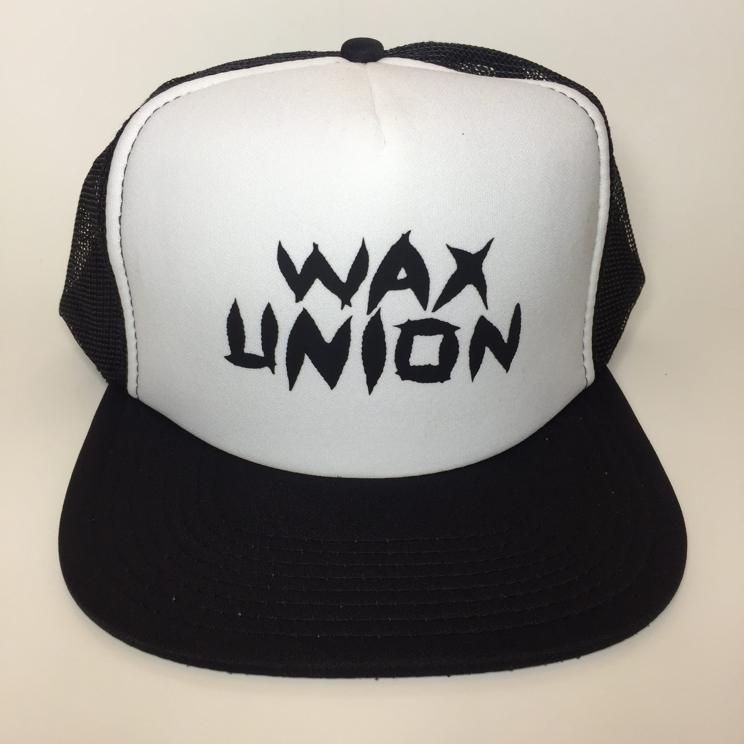 Wax Union Leaf Text Trucker Hat Black and White Front View