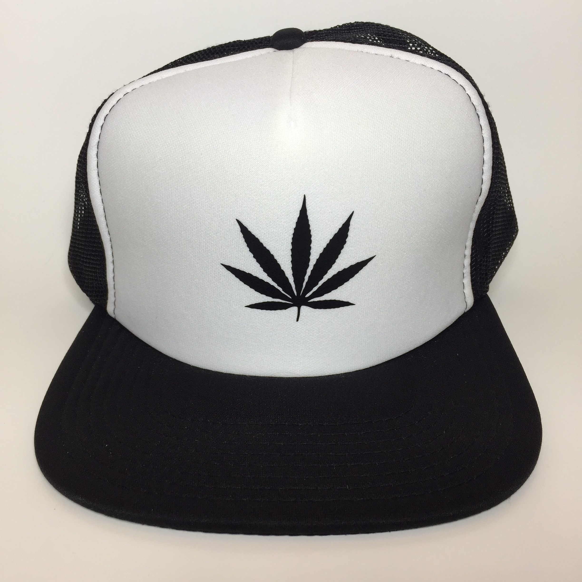 Weed Leaf Trucker Hat Black on White Front View